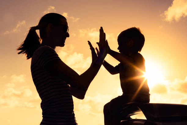 parent giving positive reinforcement to child playing a team sport