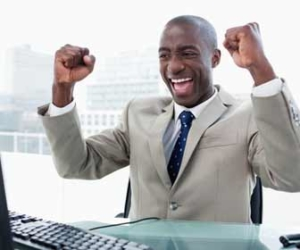enthusiastic person at computer