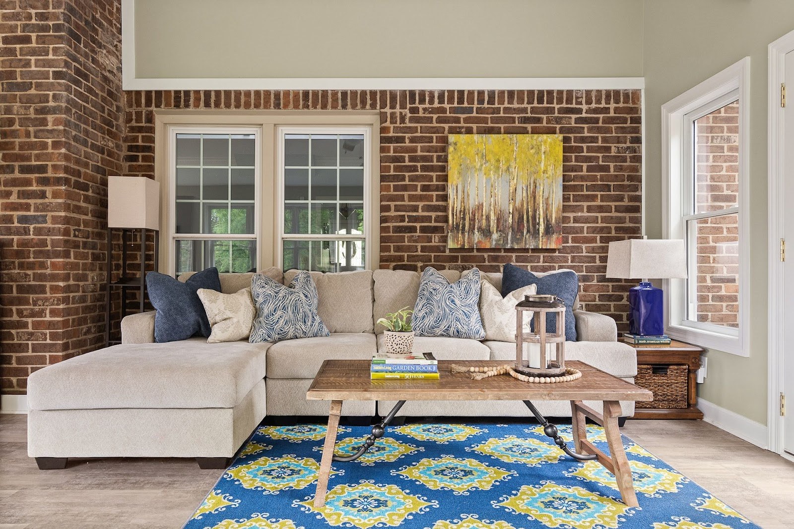 finished sunroom lebanon tennessee brick neutral paint lots of sunlight new flooring remodel art blue yellow traditional