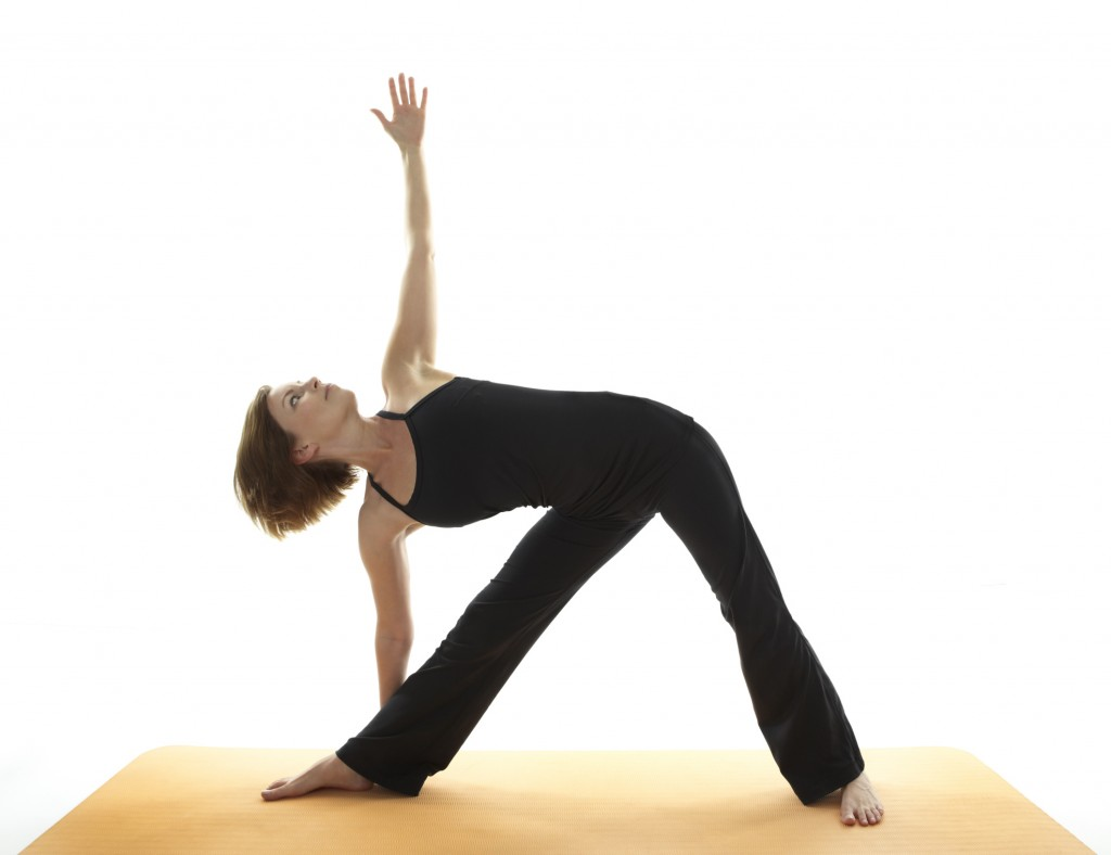 Triangle pose Yoga or Trikonasana to get rid of baby fat