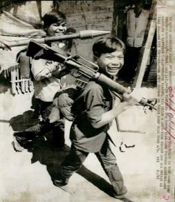 Two teenage Viet Cong soldiers at camp near Cai Lay, one carrying a captured U. automatic weapon, the other an anti-tank weapon, 1973 ~ Vietnam War Vietnam History, Vietnam War Photos, My War, North Vietnam, War Photography, American War, Korean War, Vietnam Veterans, Cold War
