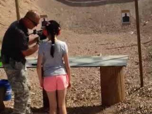 010--11-9-year-old-girl-shoots-her-gun-instr-639307.jpg