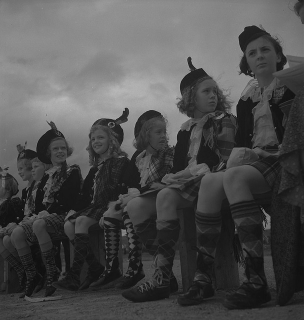 photograph of a group of young women wearing kilts