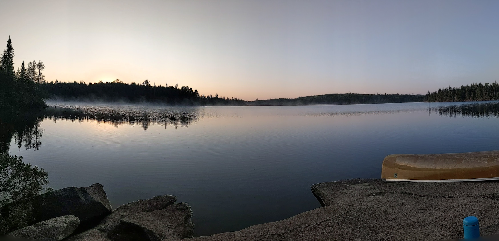 boundary waters lake with canoe