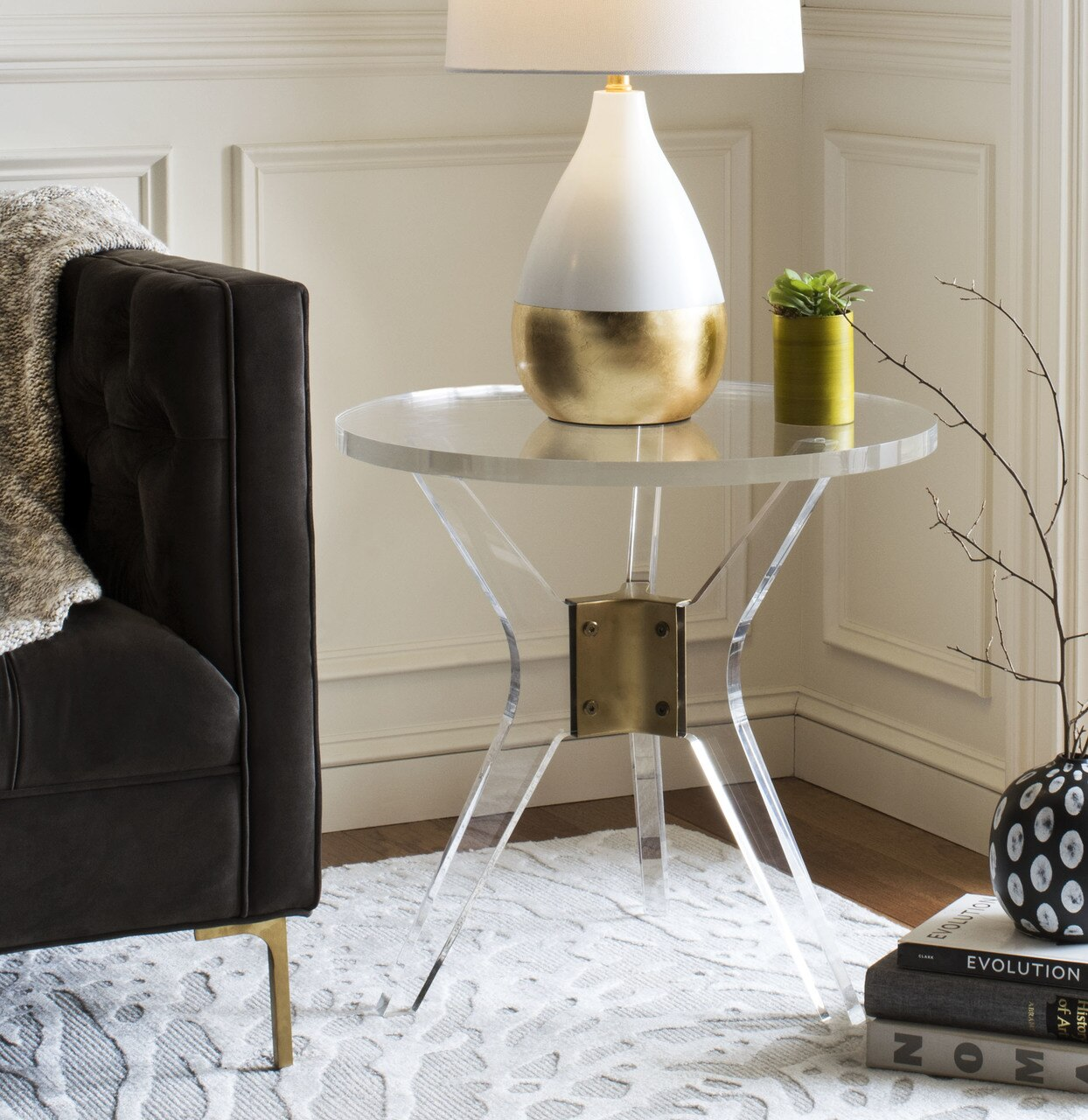 clear lucite side table with brass bracket