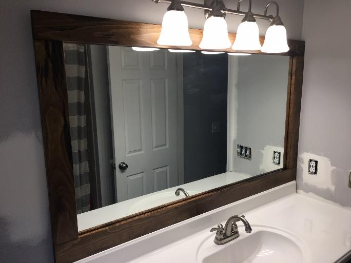 Adding the top rail to the bathroom mirror frame