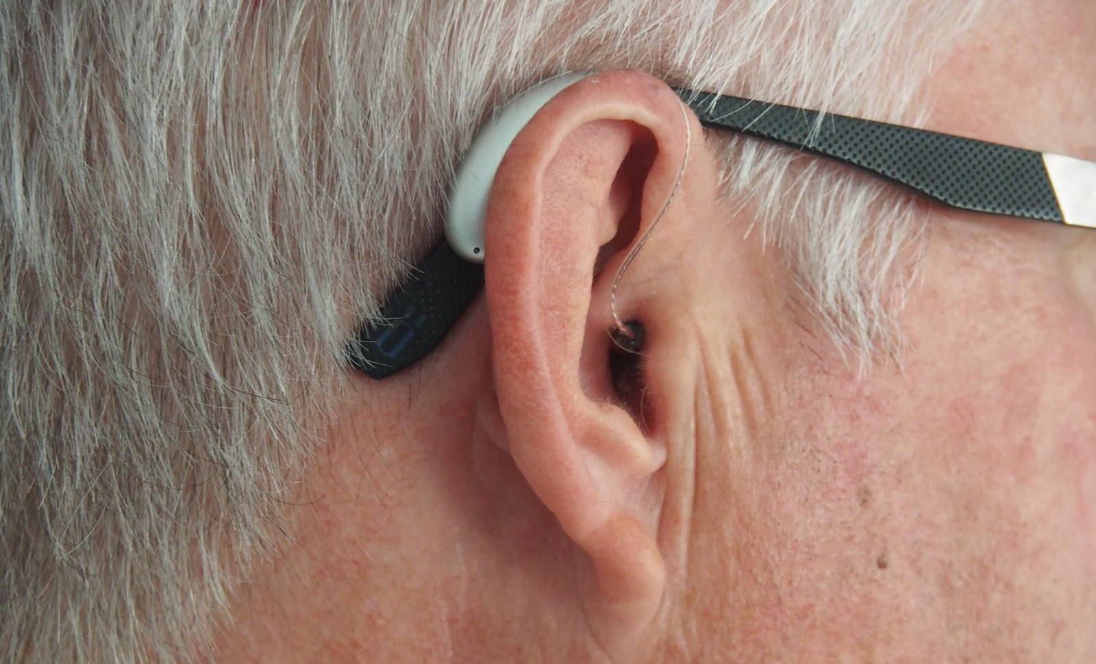 Man and his hearing aide.