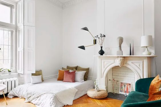 Design a Faux Fireplace Instead of a Bedside Table