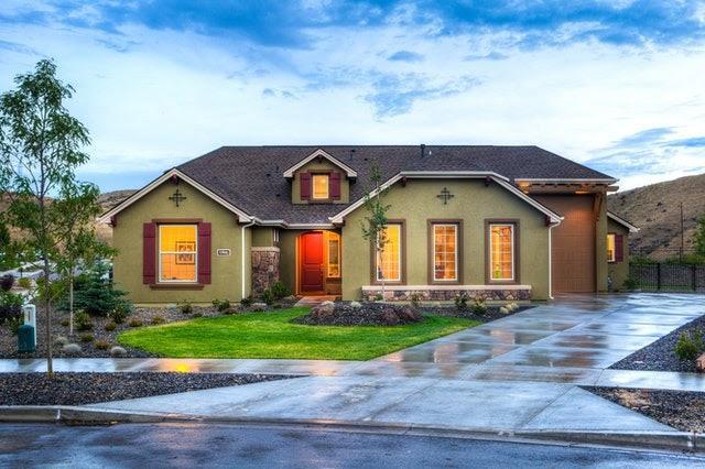 A well-lit ranch house after rain