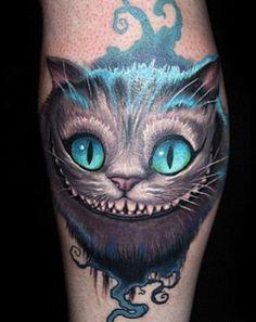 Cheshire Cat smile tattoo on back of leg