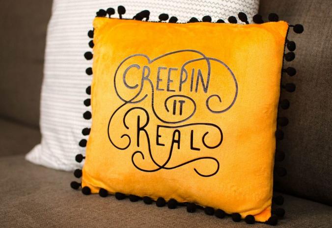 decorative halloween pillow saying creepin it real
