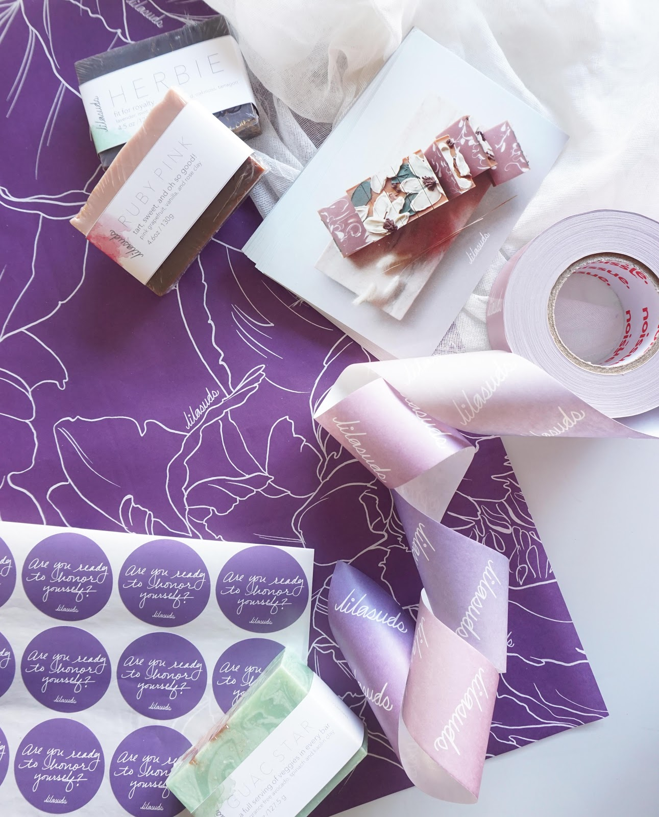 Purple tissue paper and tape packaging