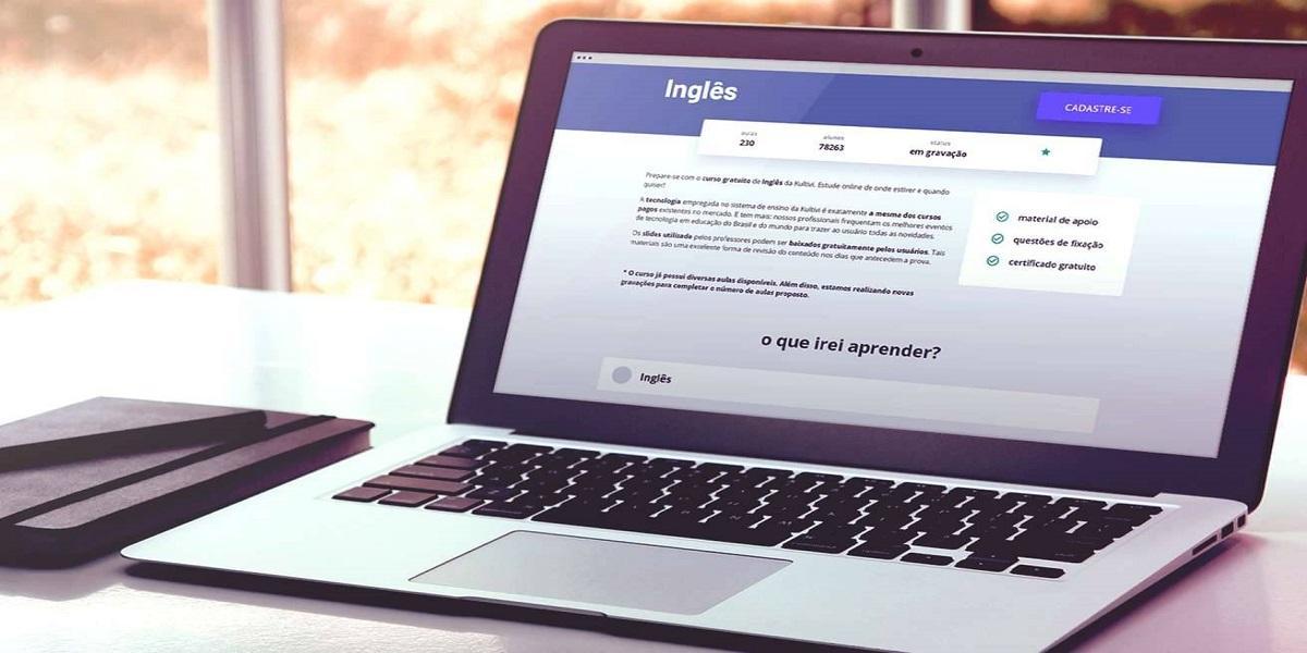 Computador portátil em cima de uma superfície branca  Descrição gerada automaticamente com confiança média