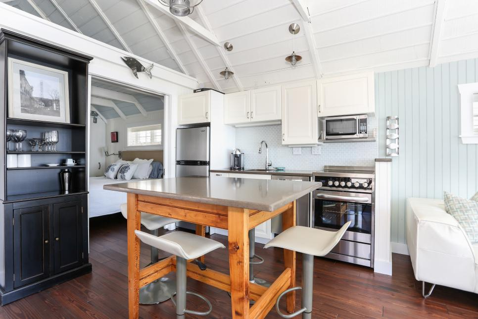 bright coastal kitchen with a 10 foot cabinet run, including stainless steel appliances. light blue wall paint and white ceilings make the room feel open and bright