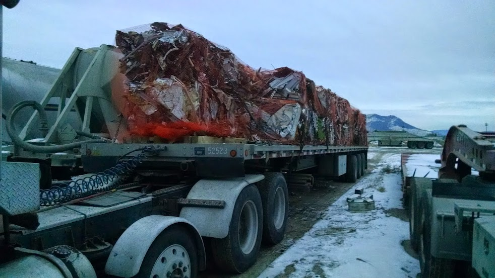 scrap metal loaded on flatbed trailer in the snow