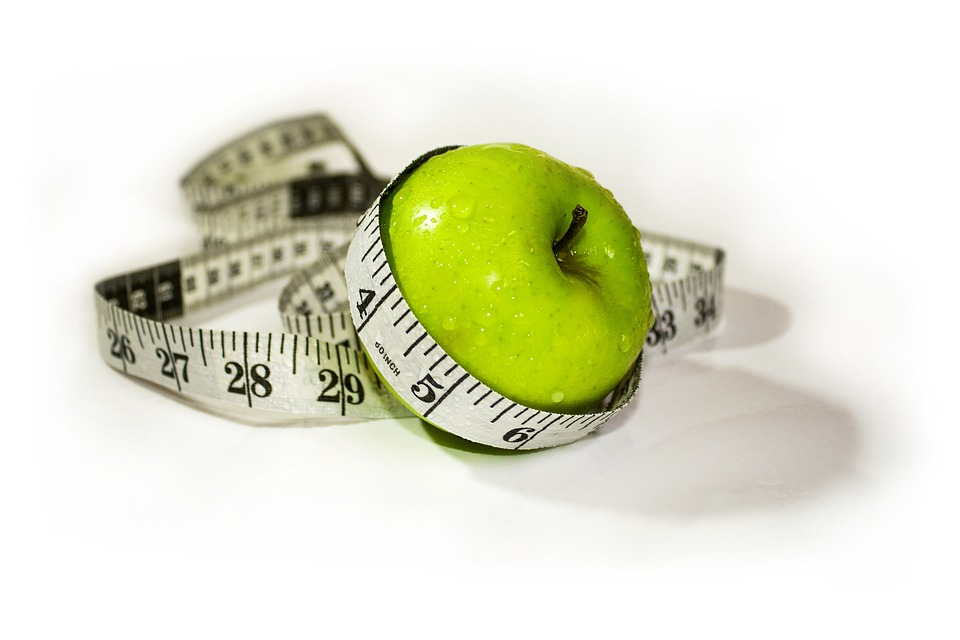 an apple covered with measuring tape