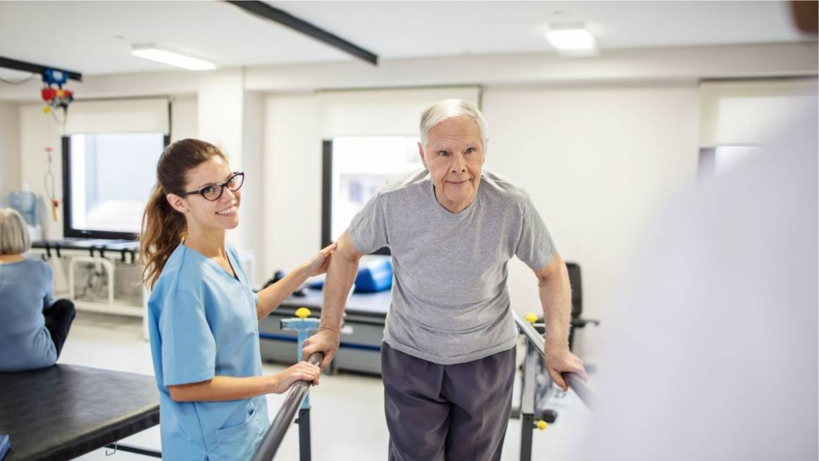 Nurse-guiding-patient-to-walk-on-slope-in-rehab