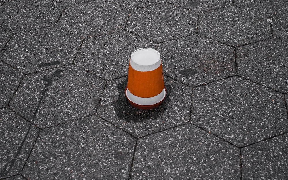 coffee cup on the ground