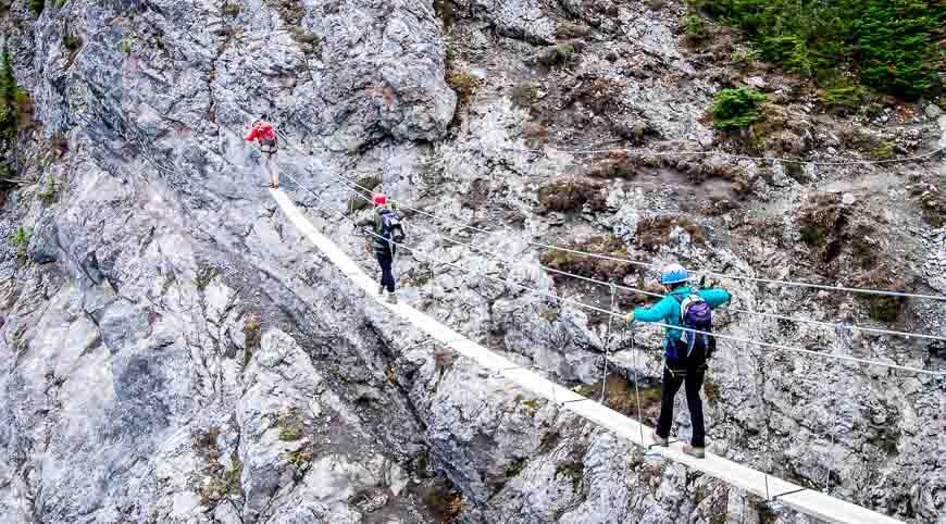 Crossing a suspension bridge as part of the Via Ferrata experience