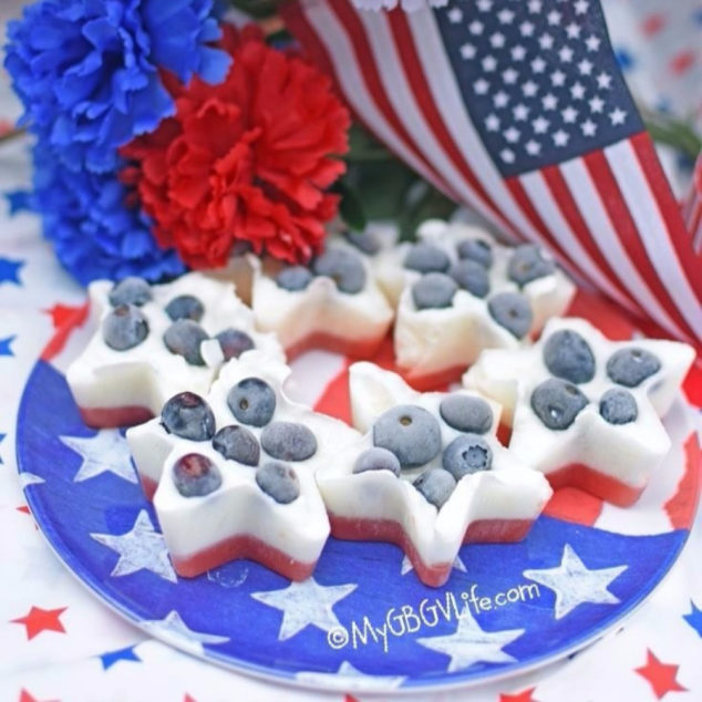 Star shaped red, white, and blue frozen dog treats on a flag plate.