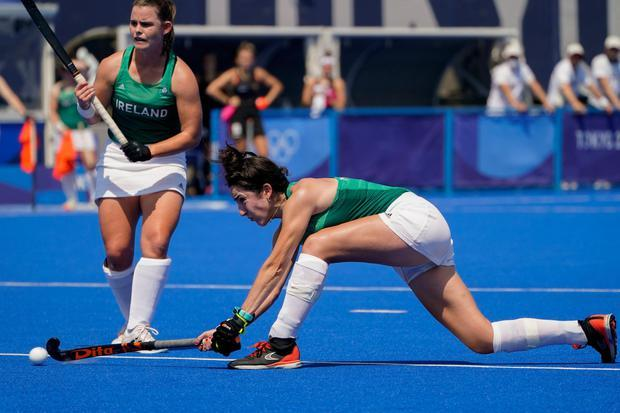 Ireland's Hannah McLoughlin scores on Germany goalkeeper Julia Sonntag during a women's field hockey match at the 2020 Summer Olympics, Wednesday, July 28, 2021, in Tokyo, Japan. (AP Photo/John Minchillo)
