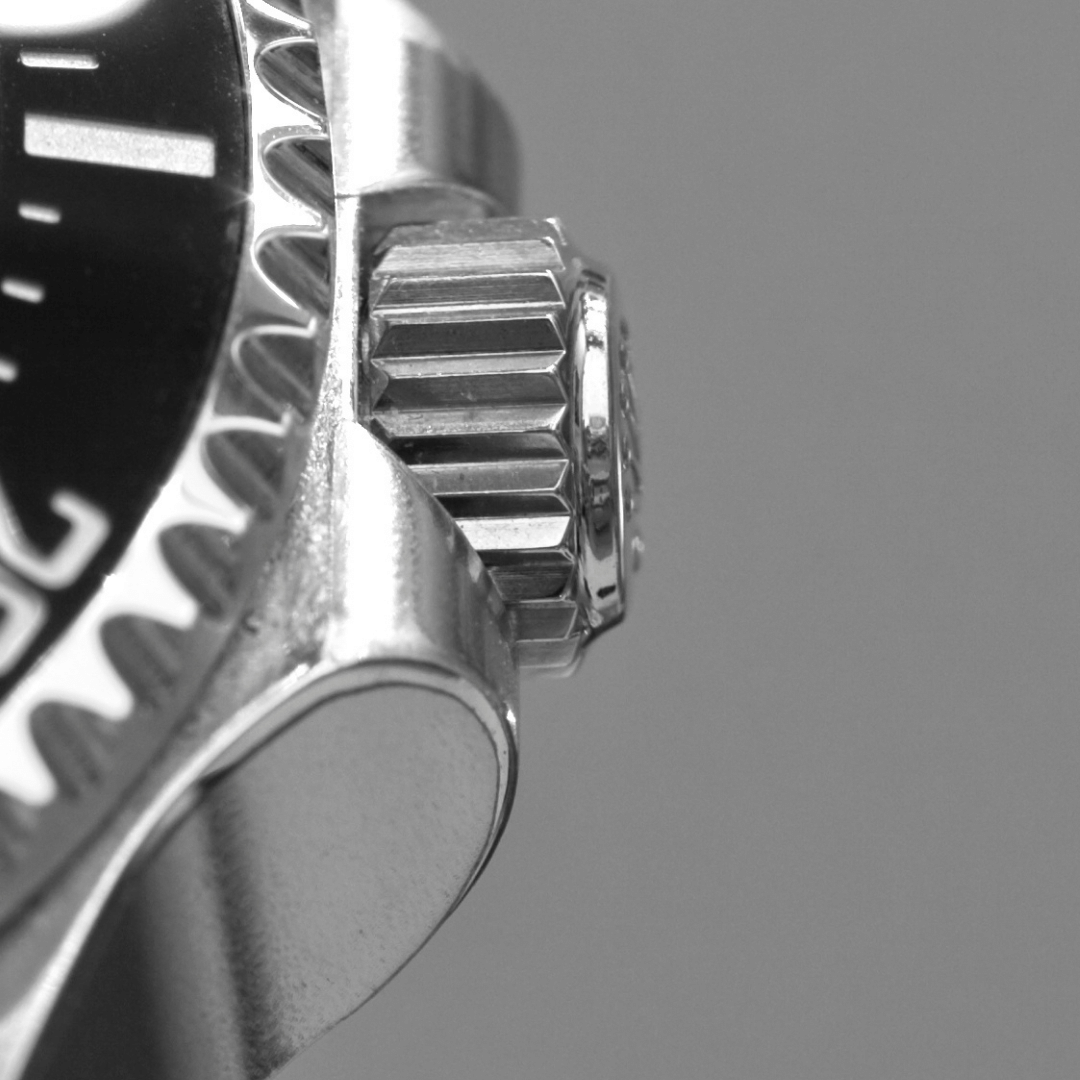 Close up photo of a watch crown with crown guards