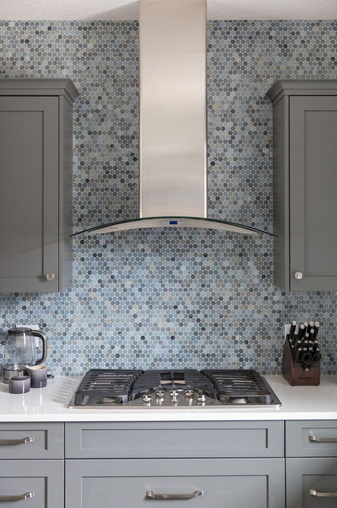 after, kitchen reveal, counter to ceiling backsplash made from mosaic blue and gray penny tiles