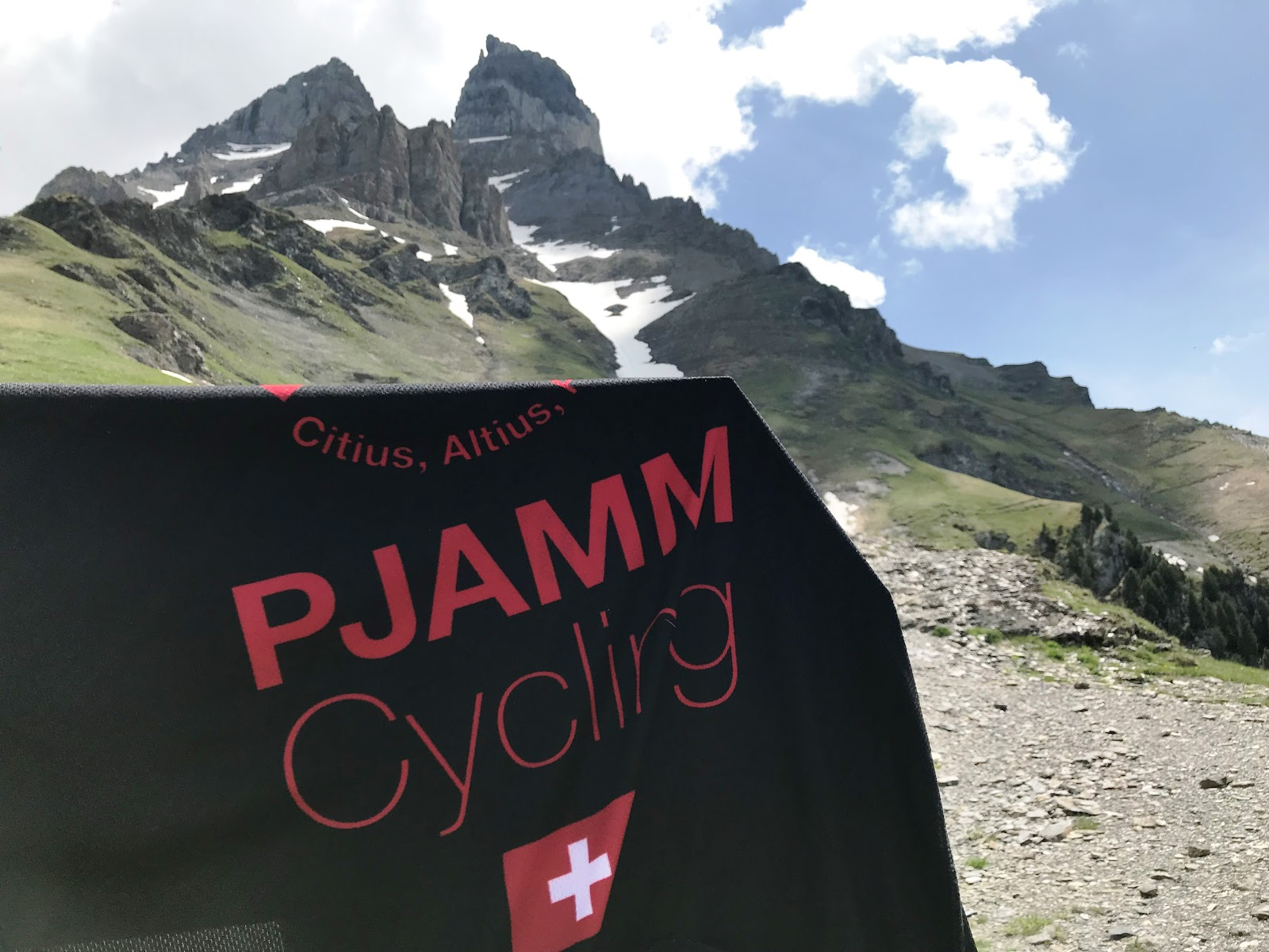 Climbing Rionda with bicycle - PJAMM jersey with La Cime de l'Est in background