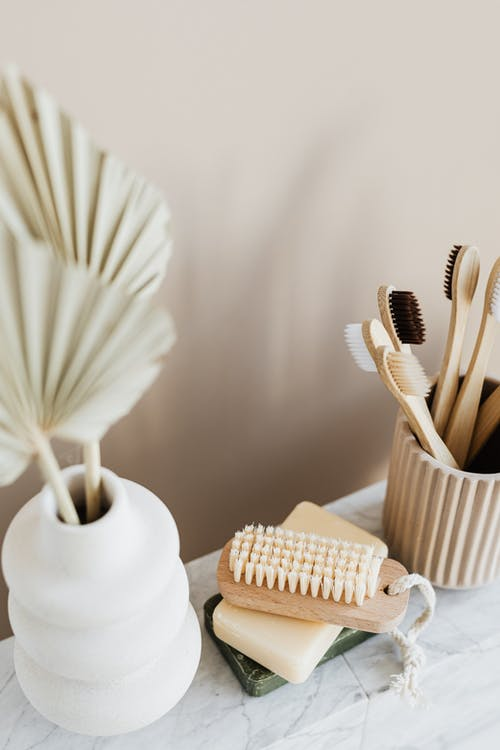 Arrangement of various eco friendly toiletries in bathroom Tips For A Better Smile