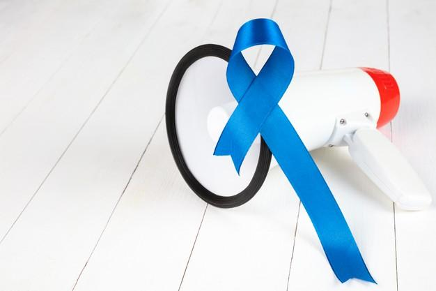 Blue ribbon symbolic of prostate cancer awareness campaign and men's health Free Photo