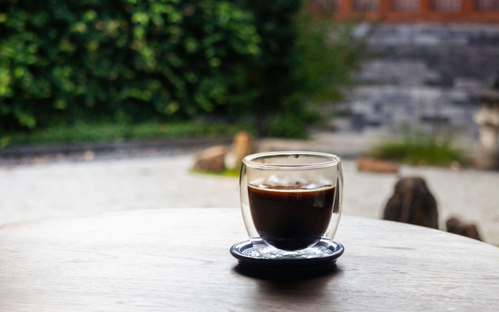 cup with espresso in garden