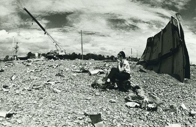 Staff Sgt. Virginia Sullivan, a public information officer at Little Rock Air Force Base when this photo was taken Aug. 27, 1981, sits in the debris field created by a fatal explosion Sept. 19, 1980, at Titan II missile silo 374-7 north of Damascus.Democrat-Gazette File Photo