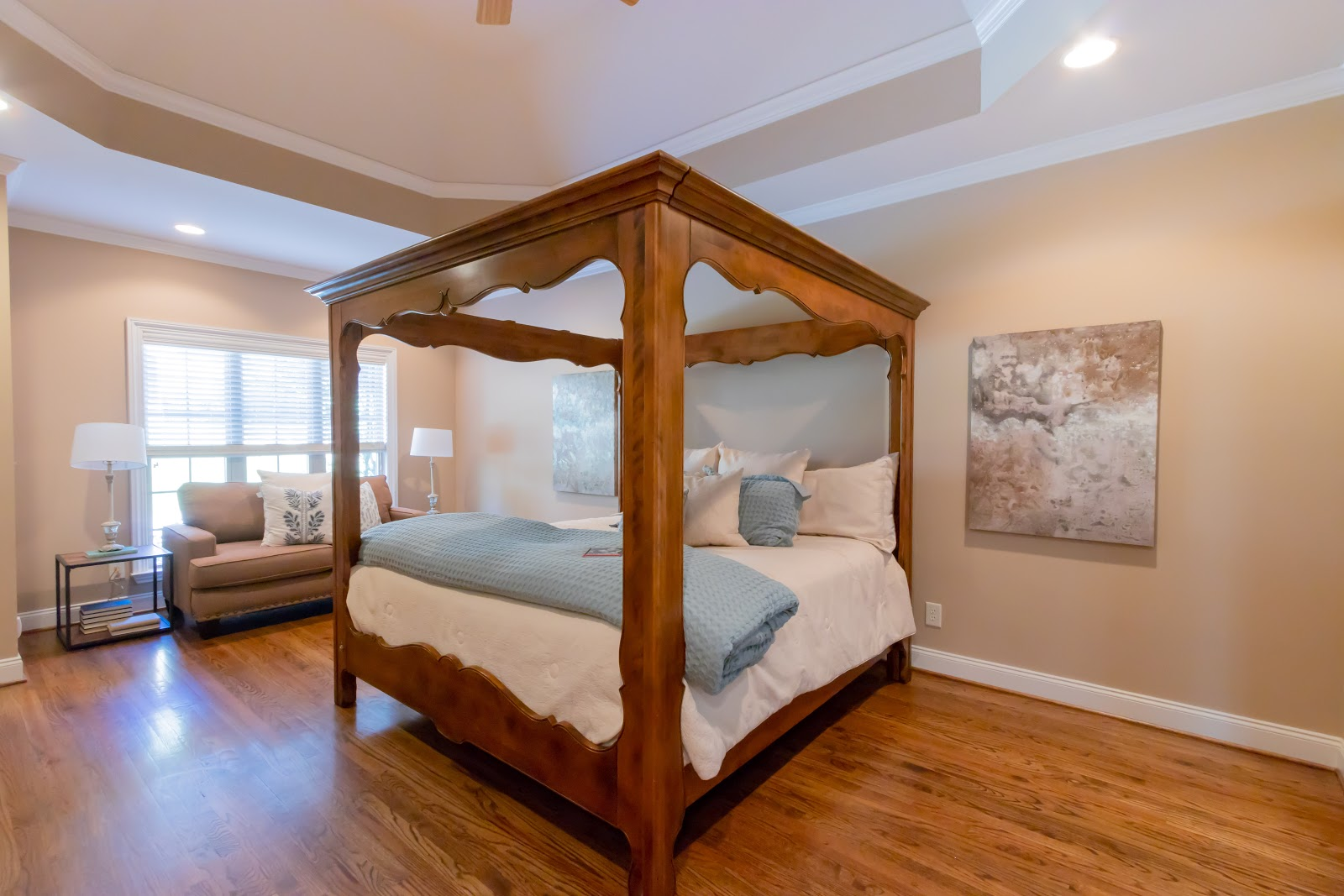 Staging your master bedroom is important for selling your home. Don't fill up the room with furniture, keep it spacious!