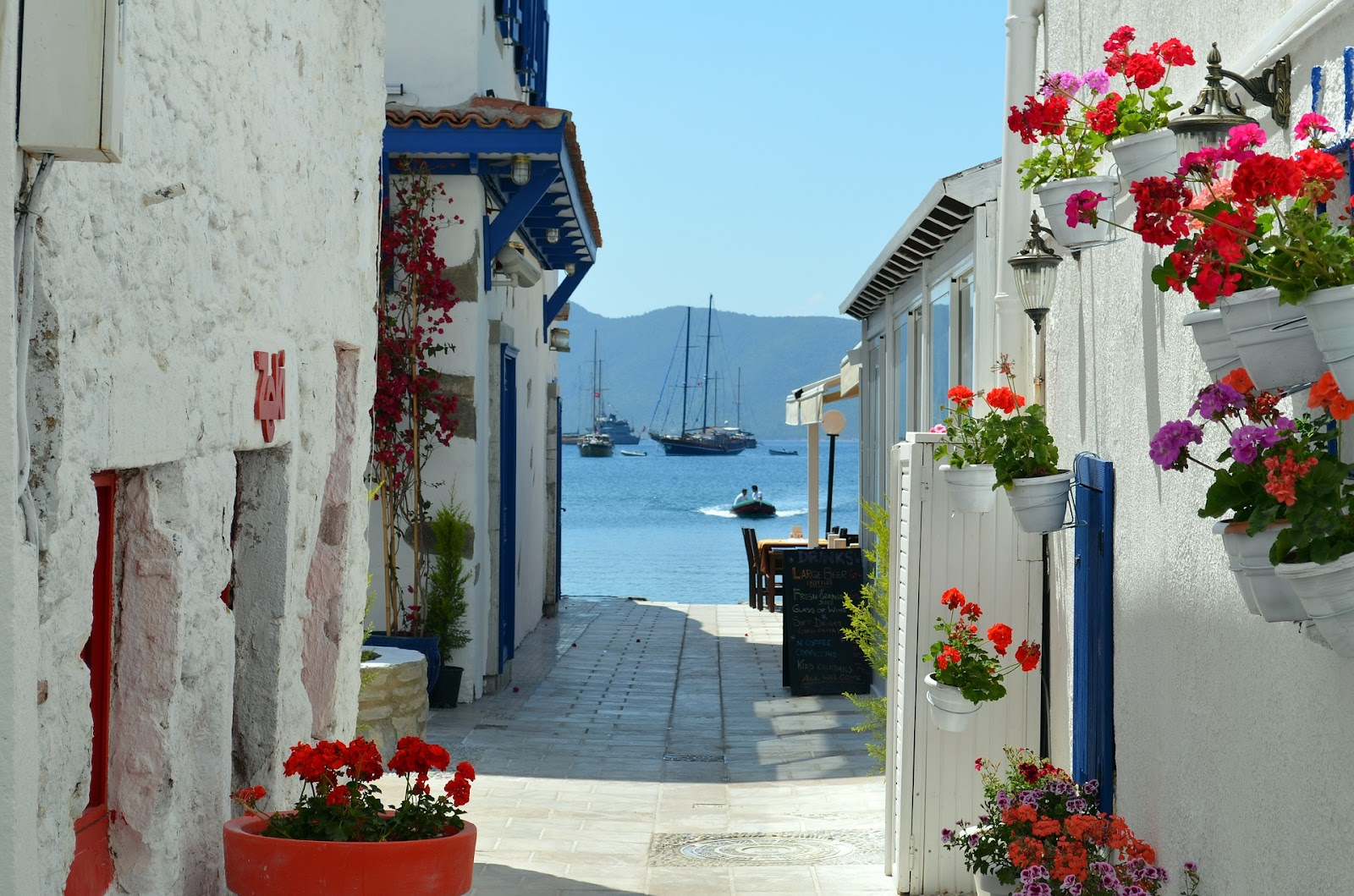 bodrum whitewashed traditional buildings and blue sea boats turkish riviera