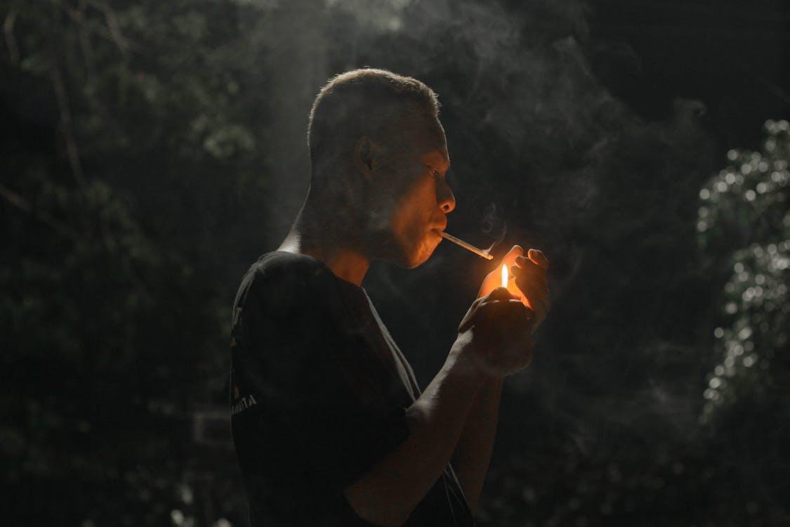 Man in Black Shirt Smoking