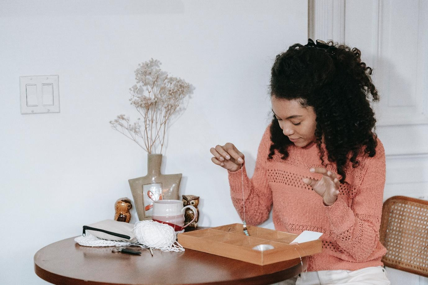 A girl sitting at a table. Work From Home Outfit Ideas So That You Always Look Amazing