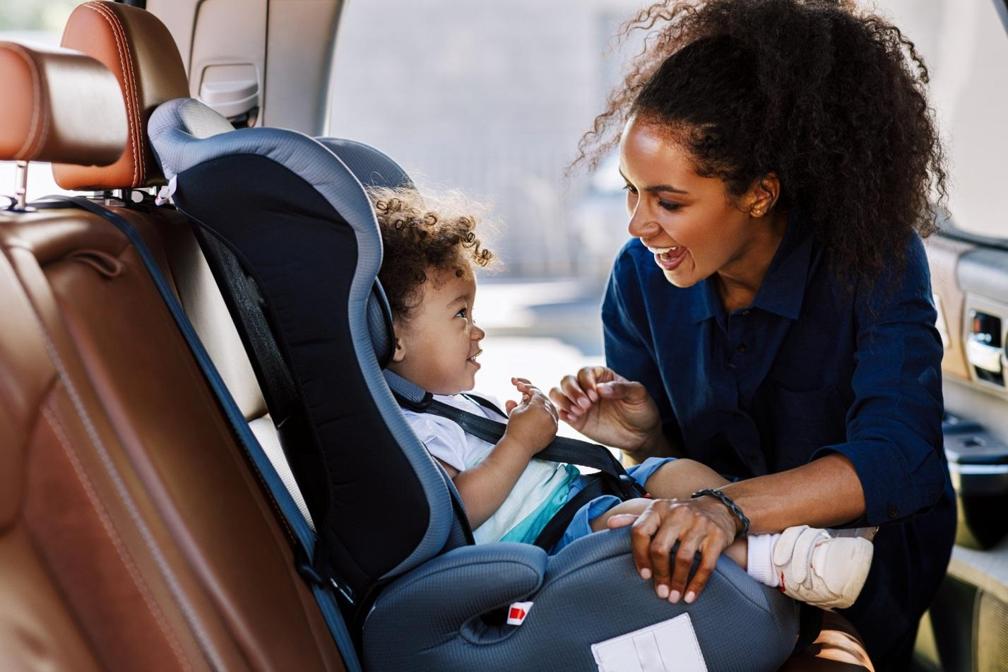 What are the rules for child seats in rental cars?