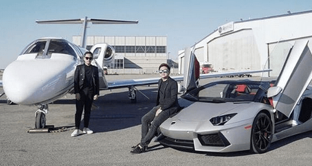 Super tan brothers Steve Tan and Even Tan standing in by a silver lambo and a white small private jet
