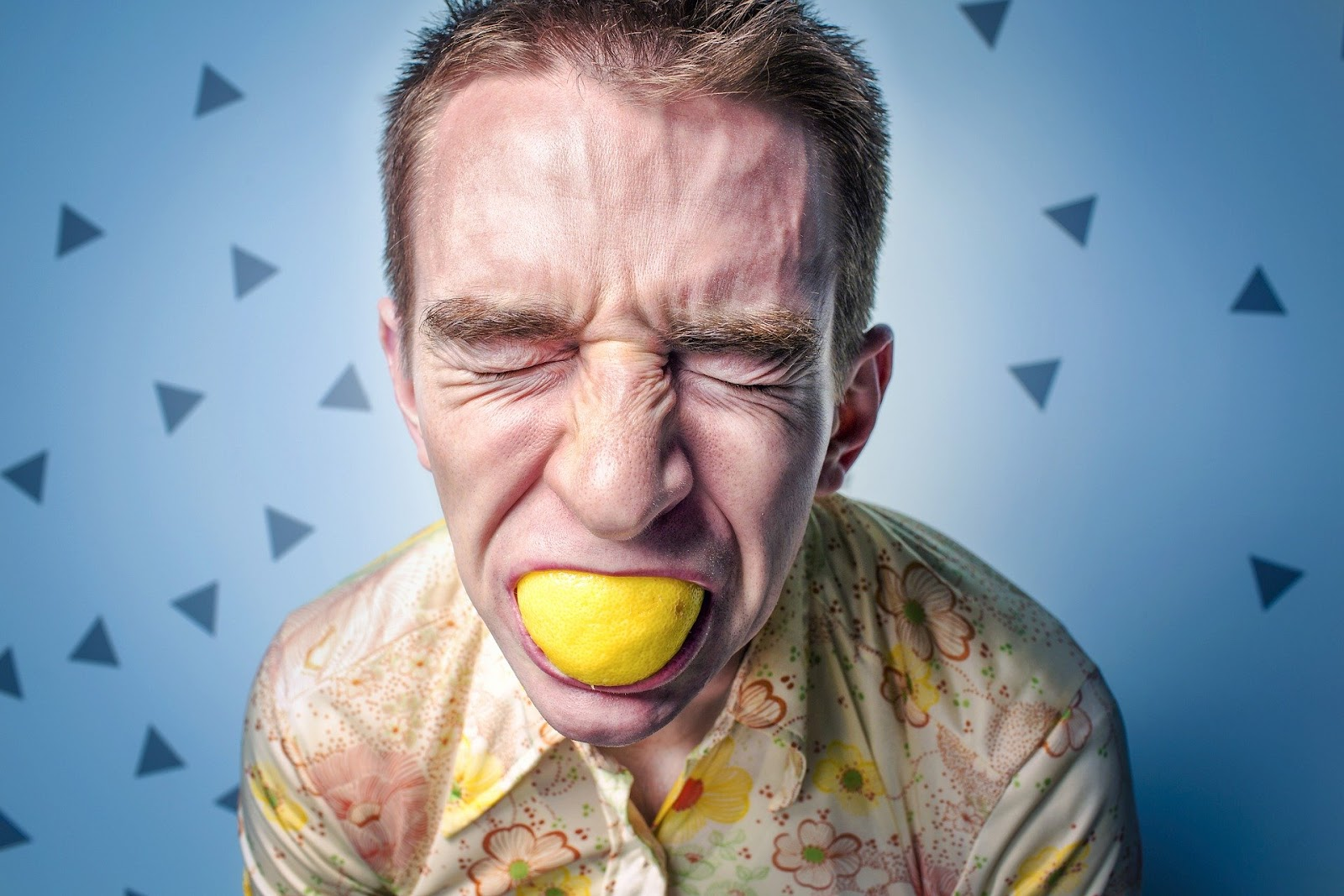 man with lemon in mouth