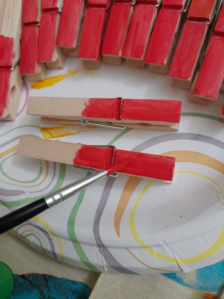painting clothespins for a DIY clothespin wreath