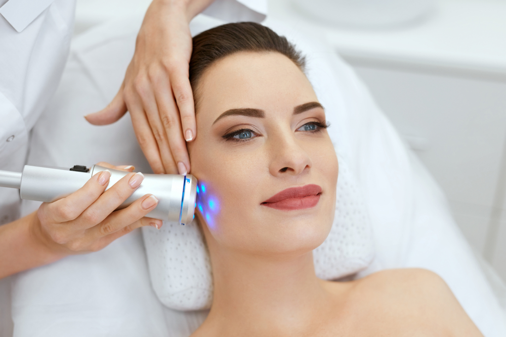 Woman getting a non-invasive skin-tightening treatment