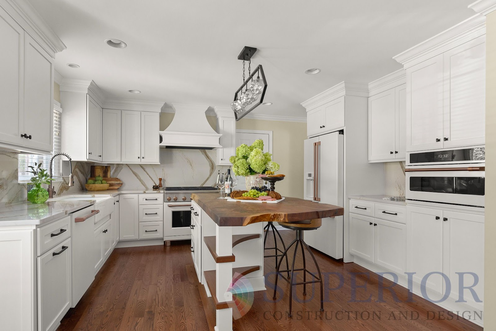 after kitchen renovation remodel custom island walnut shelving white GE cafe appliances trim statement lighting