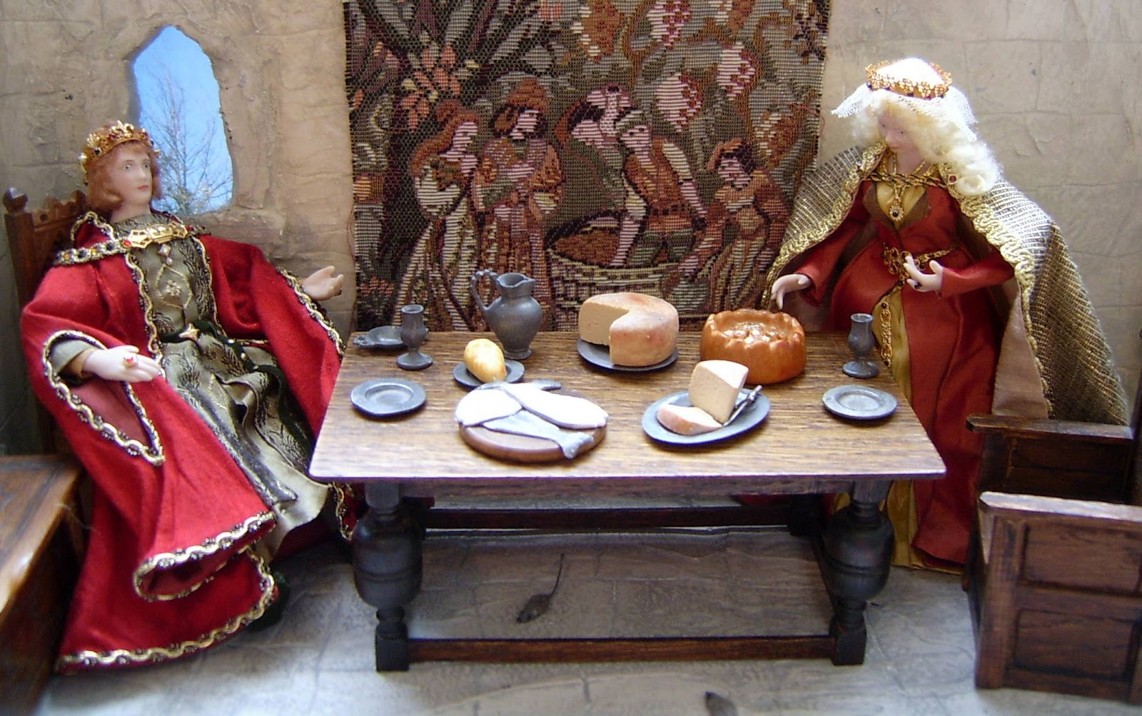 HENRY III & ELEANOR AT TABLE IN SCENE.jpg