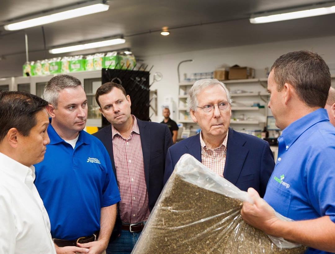 Brian Furnish and Ananda Hemp CEO Eric Wang show hemp material to Rep. Mitch McConnel