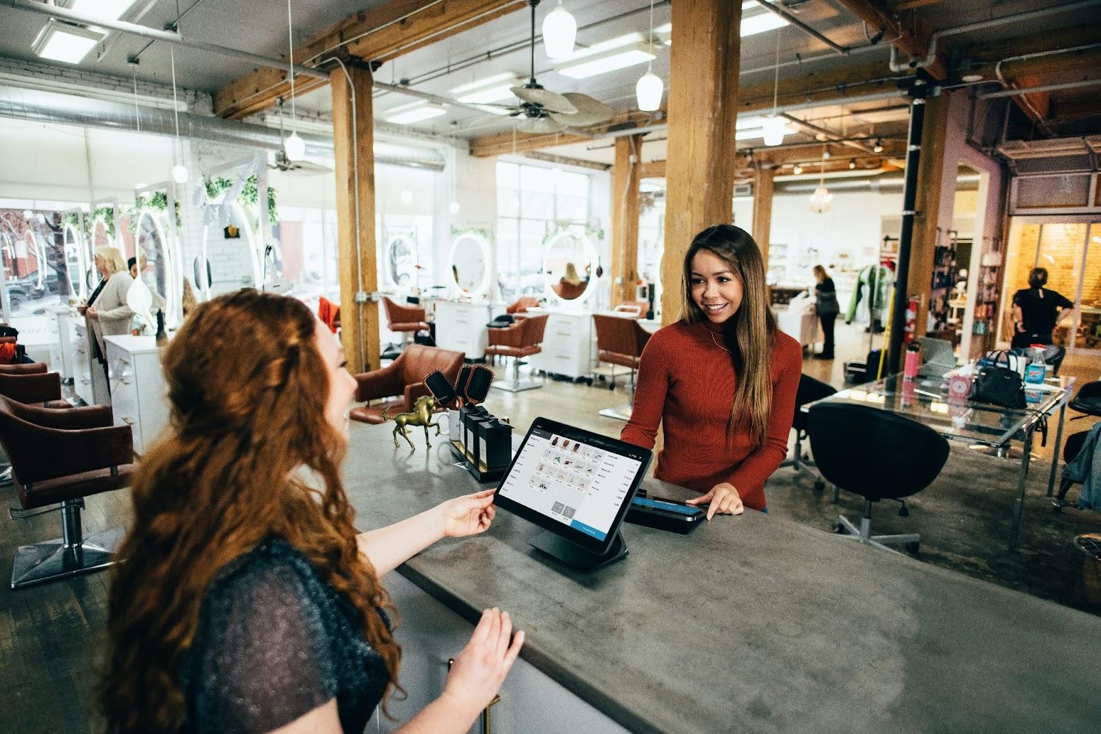 Salesperson helping a customer understand their options.