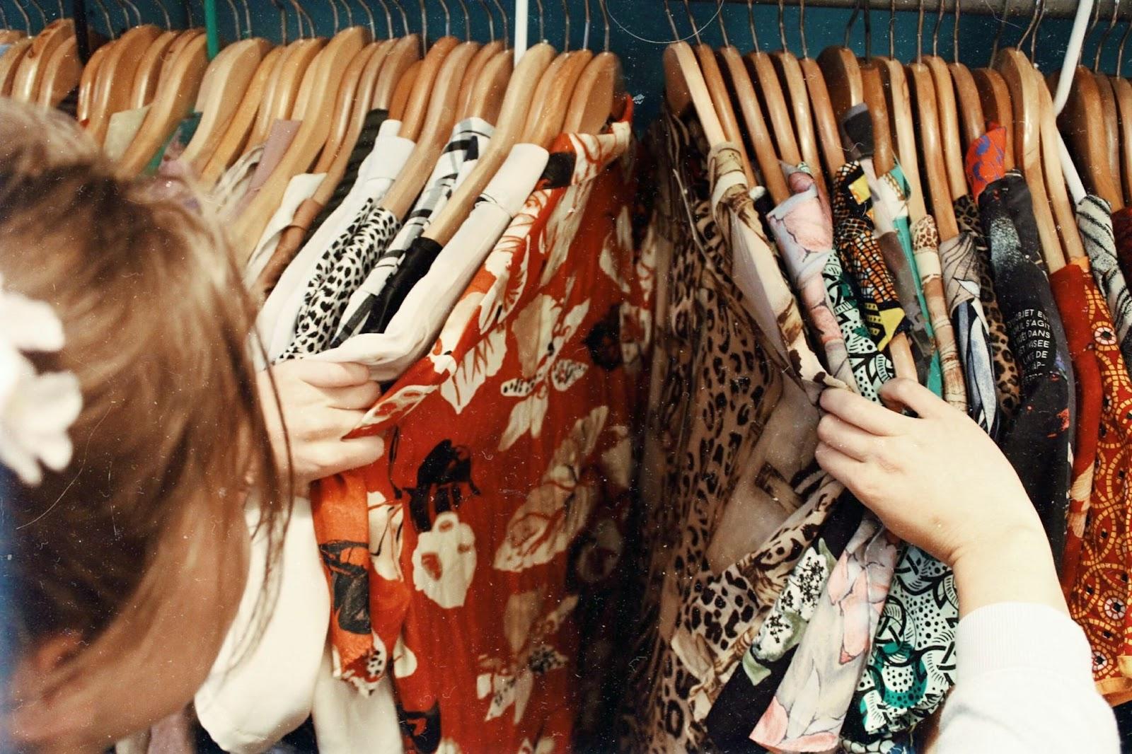 lookin through clothing rack