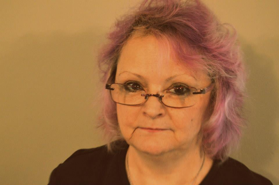 Image of Lynnette McFadzen, a white demisexual bisexual elder with purple hair
