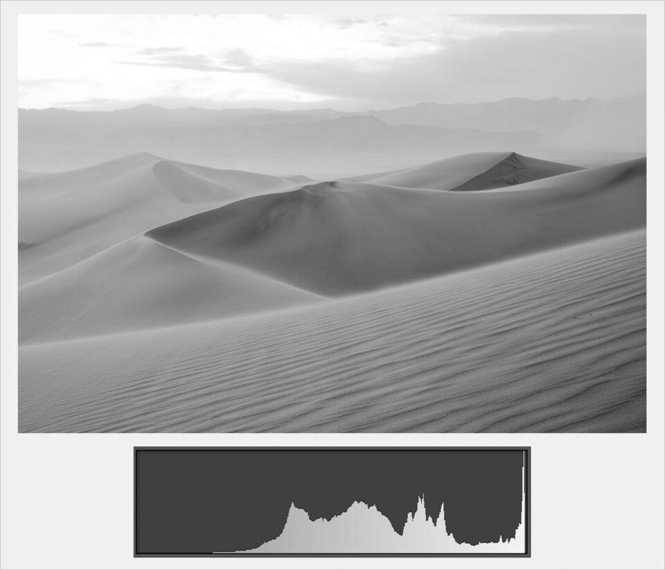 A picture containing text, nature, dune  Description automatically generated