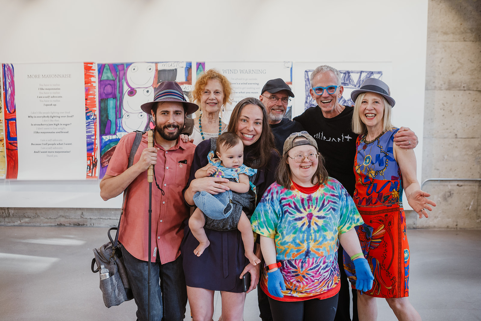 Group photo of Teresa Pocock with friends from Gallery Gachet, Franke James and Billiam James. Photo: This Is It Studios.