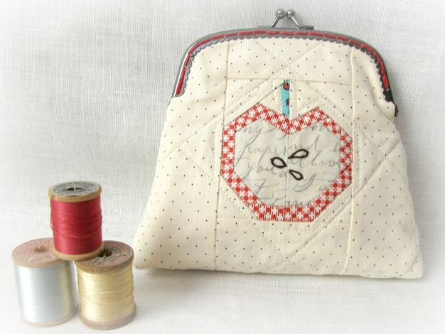Quilted Pouch Featuring Apple, Beside Spools of Thread